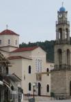 Το καμπαναριό και η εκκλησία της Ευαγγελίστριας